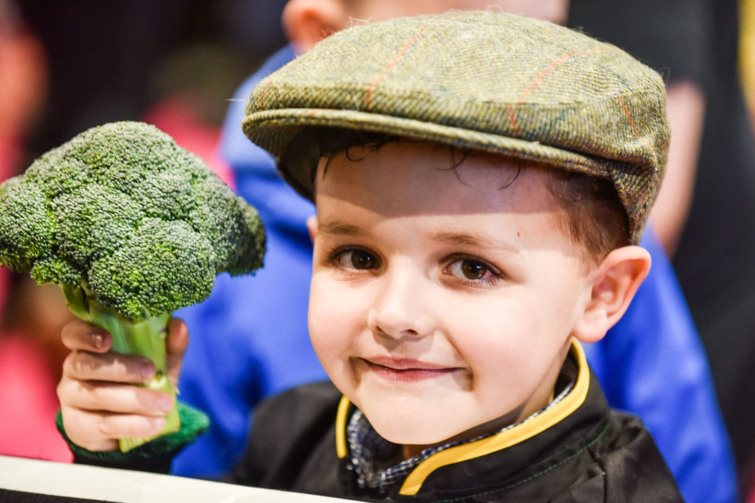 Little boy with broccoli at Springtime Live